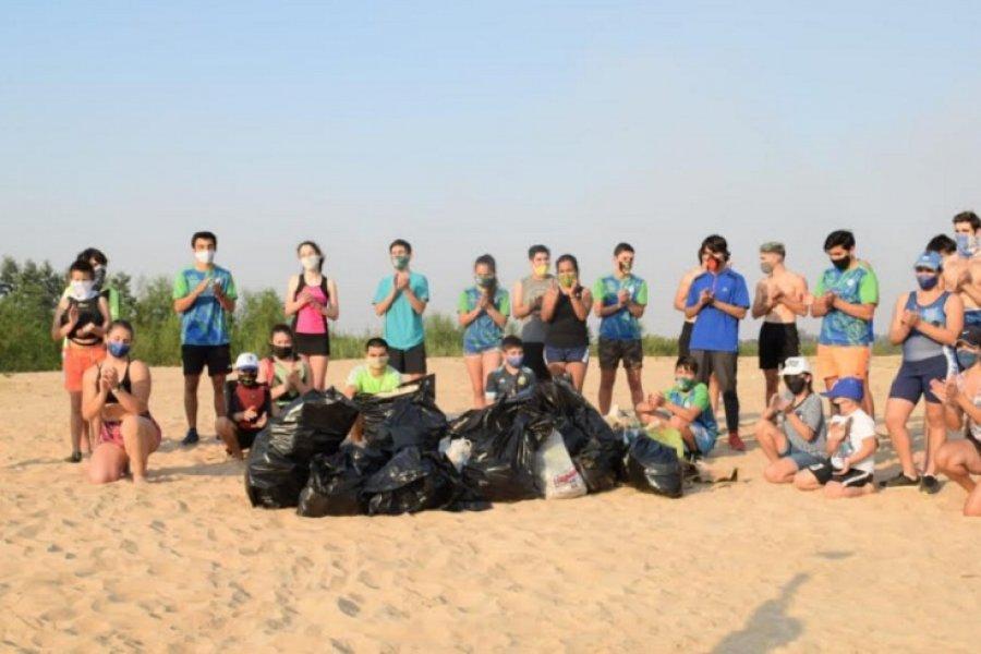 Remo y Optimist se unieron para limpiar el Paraná
